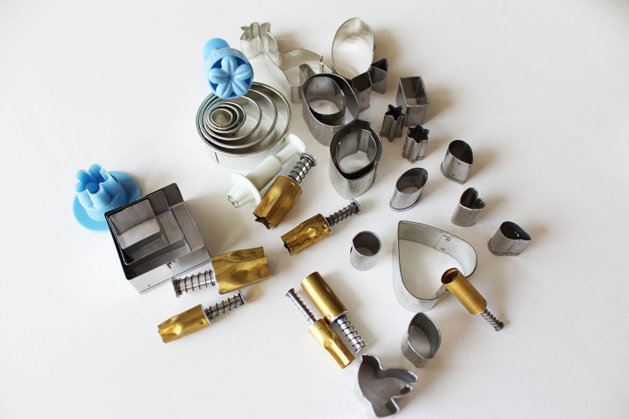 Some of my cutters and extruders for polymer clay jewelry making.